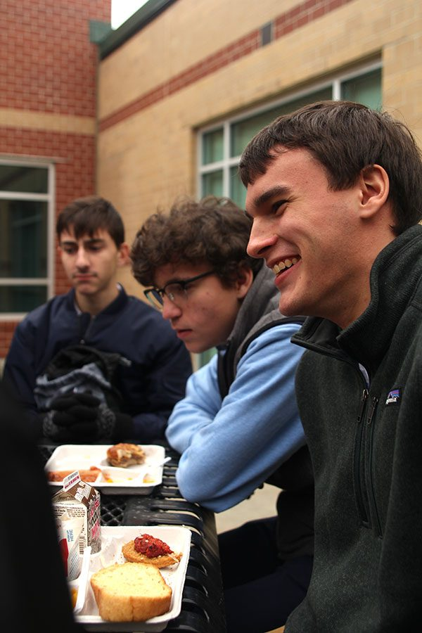 After committing to eat outside every blue day, senior Justin Grega laughs with the other seniors on Wednesday, Jan. 10.