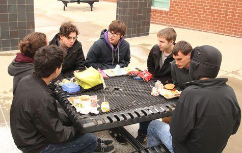 Senior boys enjoy lunch outside despite freezing temperatures