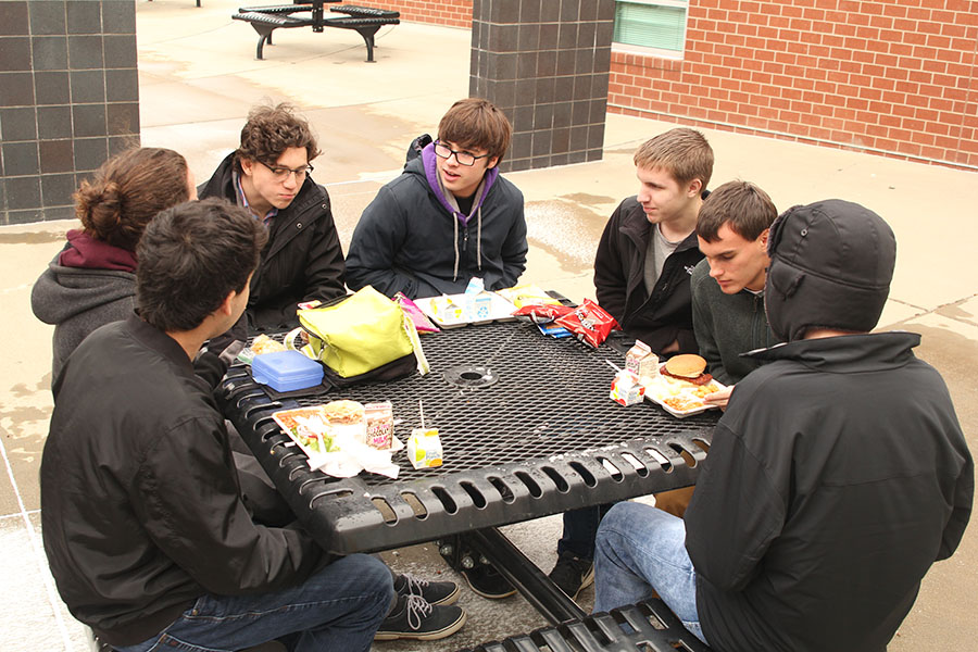 Taking advantage of senior privileges, the group of seniors eat outside on Tuesday Jan. 23, despite the 28 degree weather.
