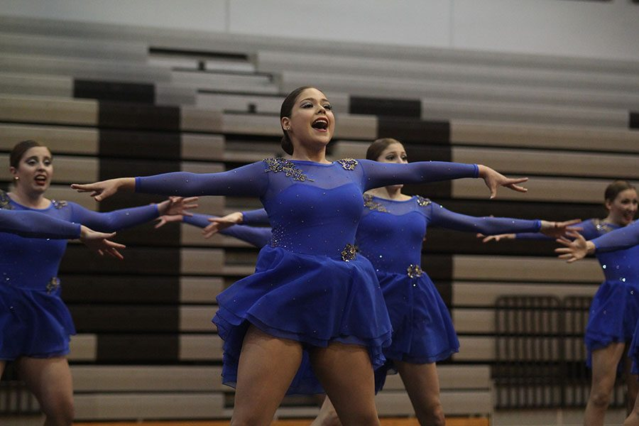 During their jazz performance, sophomore Sammie Pennington dances to
