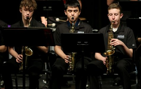 Looking at their music, freshman John Fraka, junior Tommy Tanaka and junior Kaiden Julian perform pieces selected for the annual jazz band concert on Thursday, Mar. 1.