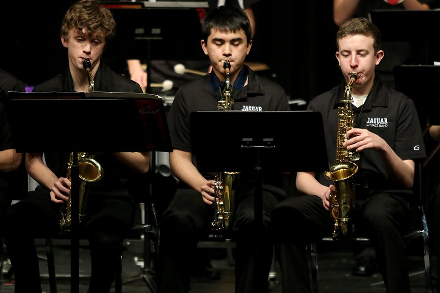 Looking+at+their+music%2C+freshman+John+Fraka%2C+junior+Tommy+Tanaka+and+junior+Kaiden+Julian+perform+pieces+selected+for+the+annual+jazz+band+concert+on+Thursday%2C+Mar.+1.