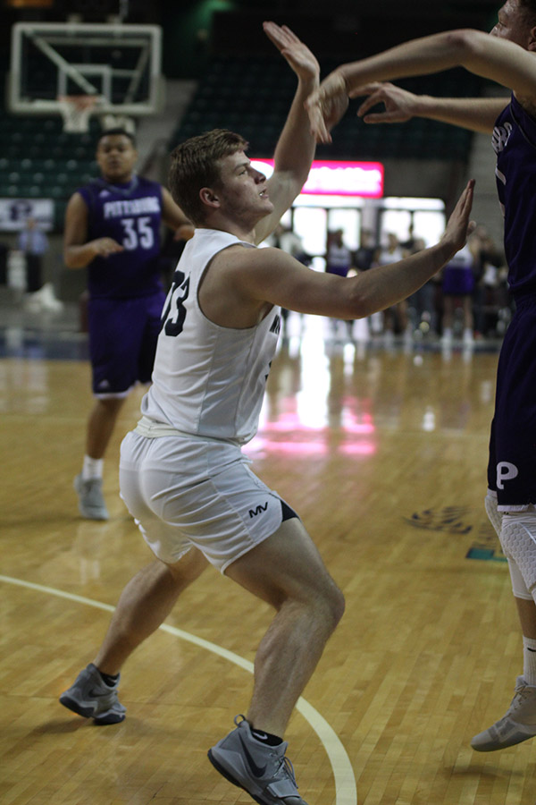 With+his+arms+up%2C+senior+Brody+Flaming+attempts+to+block+a+Pittsburg+pass.+