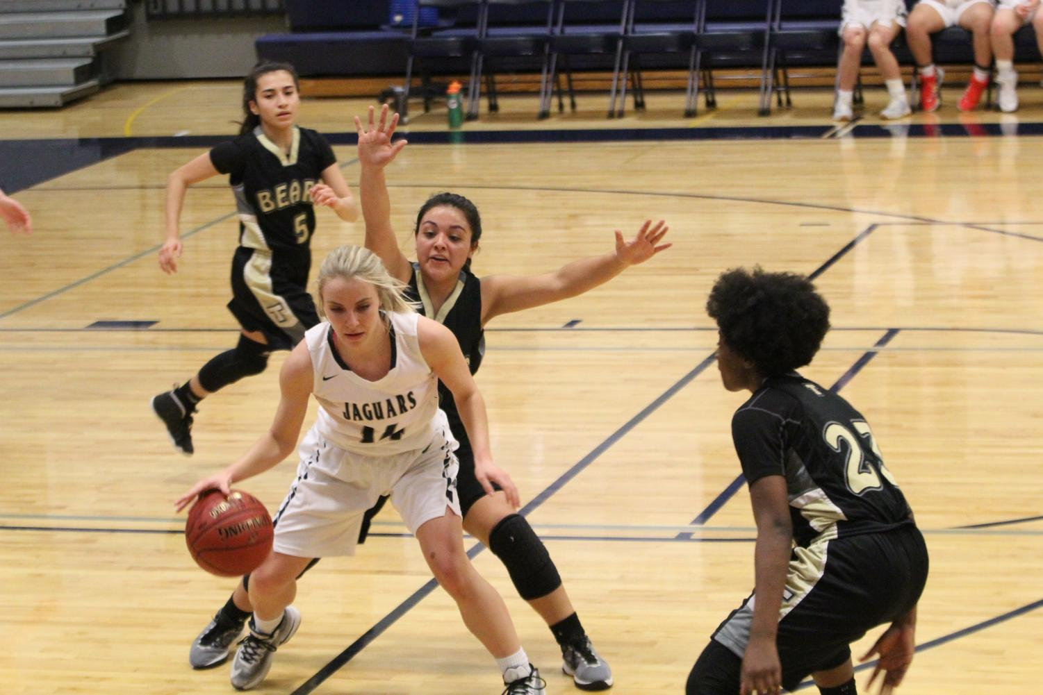 Dribbling+around+her+opponent%2C+senior+Addie+Hinkle+tries+to+get+the++ball+to+a+fellow+teammate.