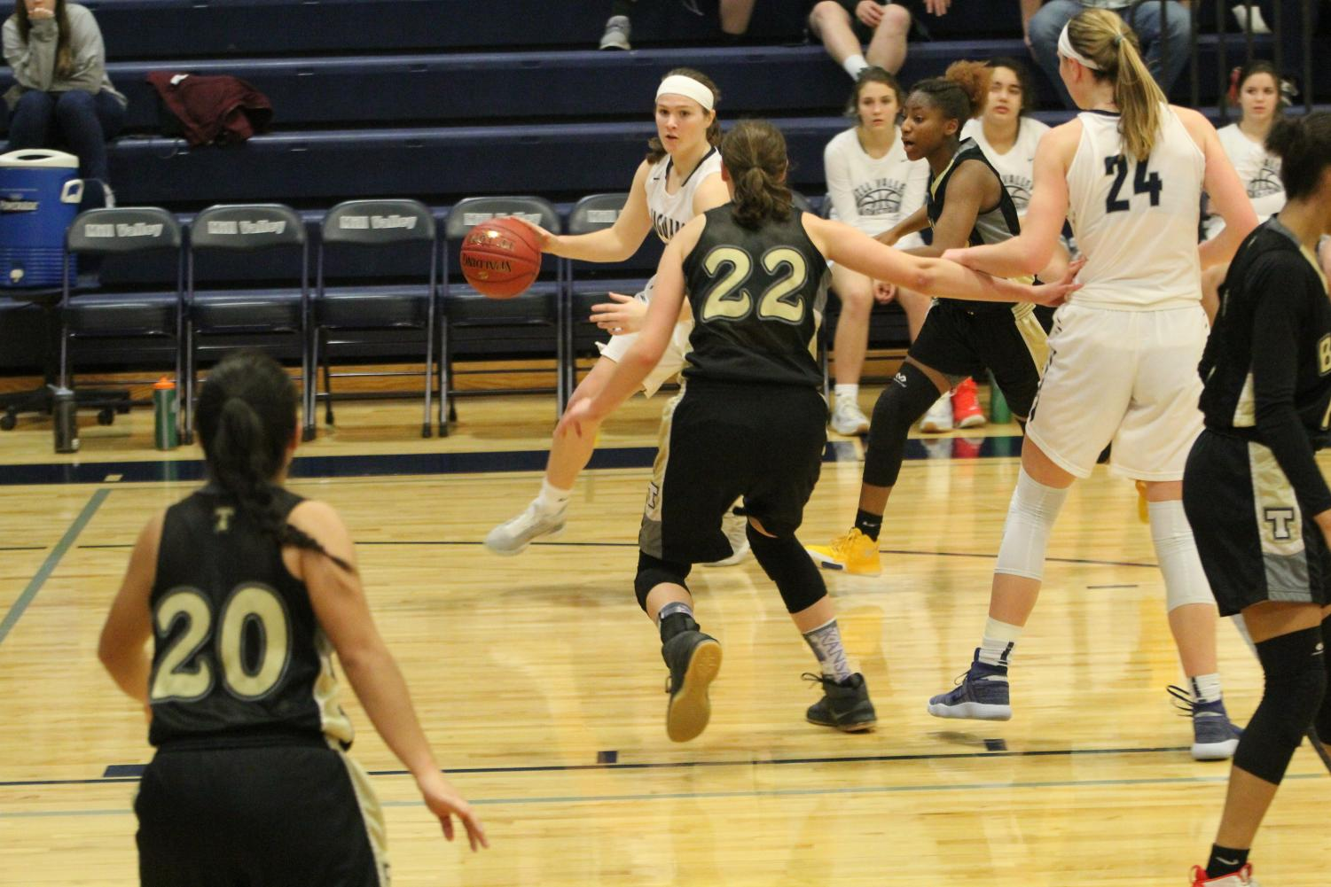 Dribbling+around+her+opponent%2C+junior+Claire+Kaifes+gets+ready+to+pass.+