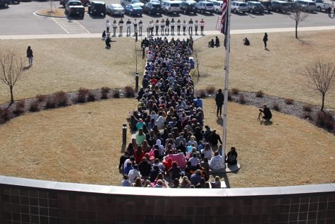 Students participate in peaceful walkout to recognize victims of school shooting in Florida