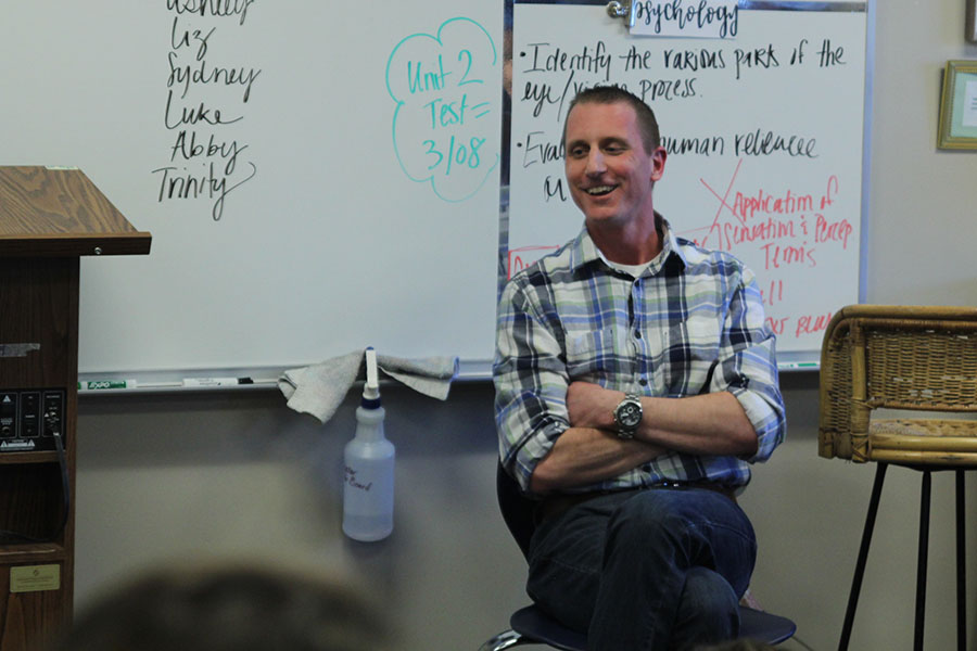 The guest speaker, a psychotherapist, Lane Laird smiles while answering a question on Friday, March 2.
