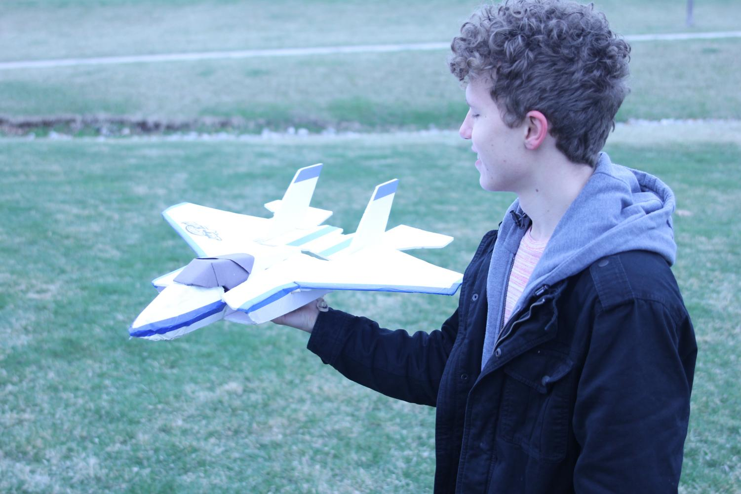 Senior Zach King prepares to launch the plane with his arm in an attempt to create lift on Sunday, March 25.