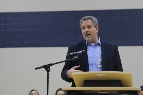 District Superintendent Frank Harwood speaks during graduation. Harwood, along with all other Johnson County school districts, put out a statement announcing school closures Monday, March 16.