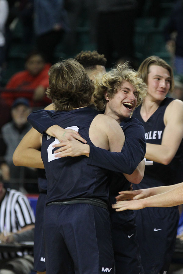 After+the+game%2C+senior+Colton+Hinkle+embraces+senior+Cooper+Kaifes.