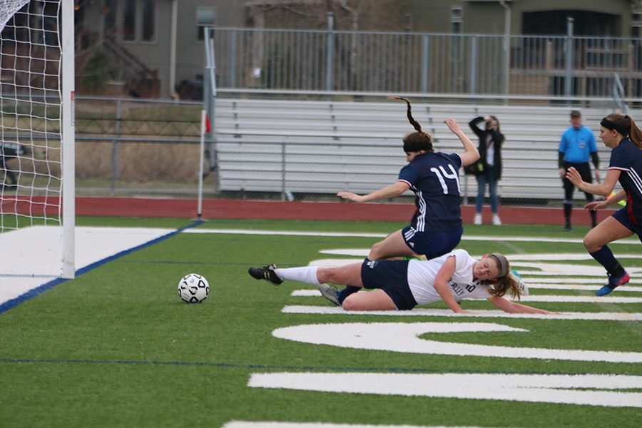 At+the+beginning+of+the+game%2C+senior+Cori+Carver+slides+to+score+a+goal.