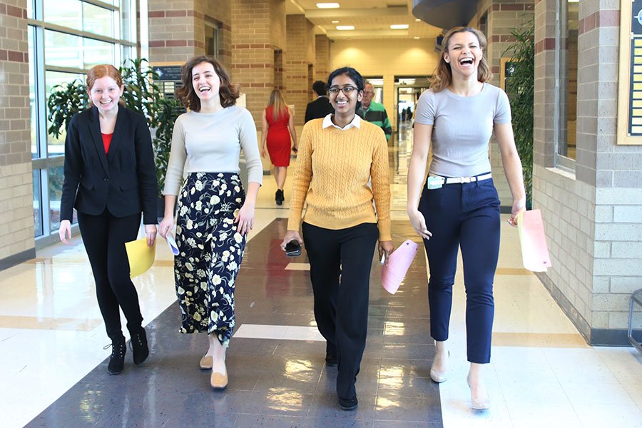 Juniors Grace Johnson, Lauren Rothgeb, Elizabeth Joseph and Lucy Graff make their way to the rooms where they will compete on Saturday, Mar. 3.