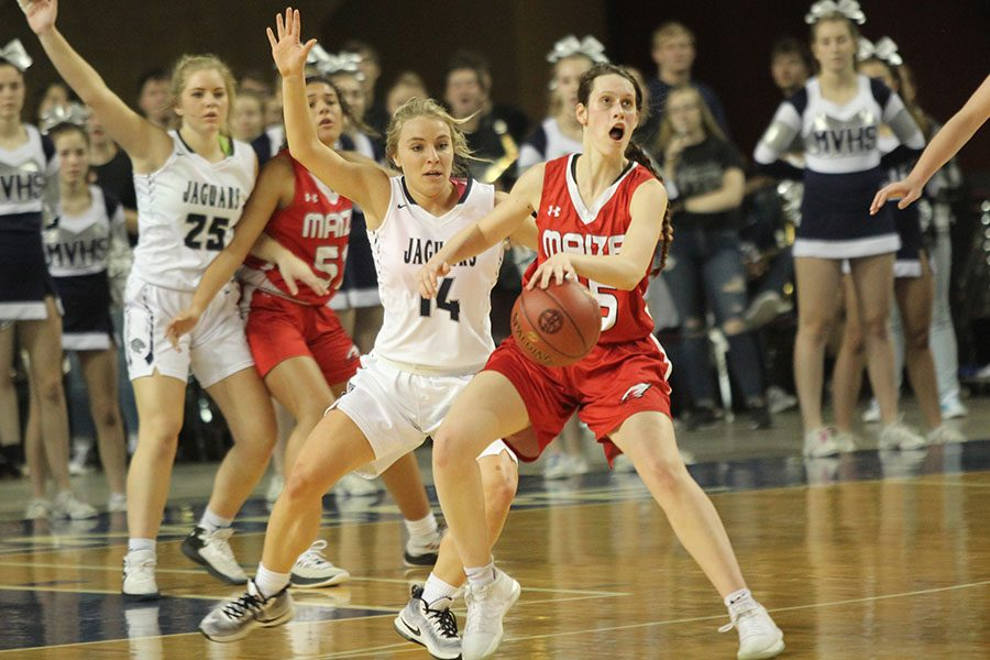 After rushing back on defense, senior Adde Hinkle closely guards a Maize player.
