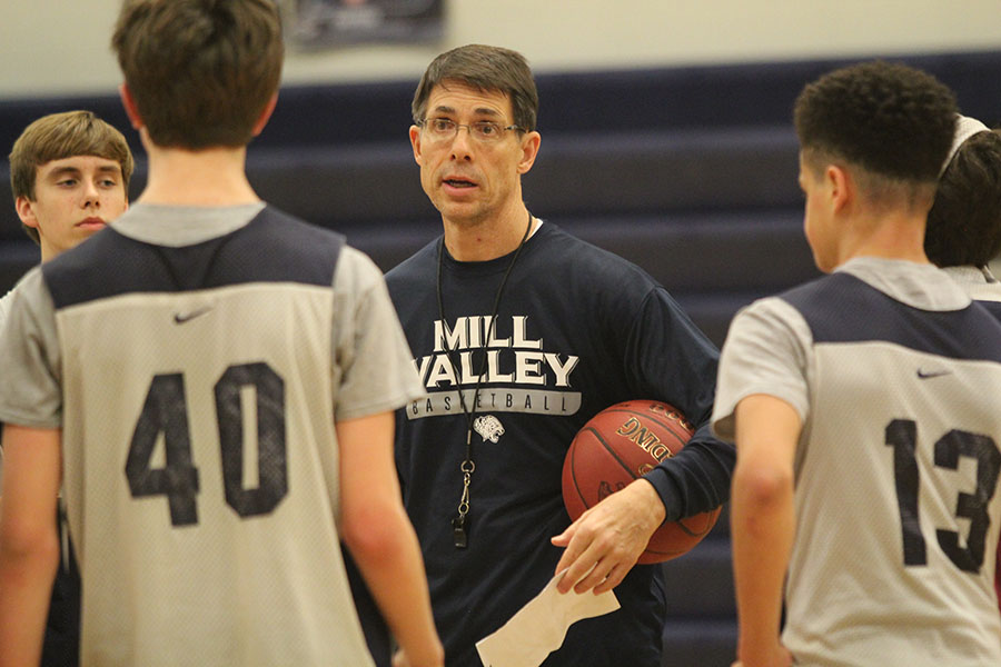 During practice on Friday, Feb. 23, sophomore basketball coach Steve Bock instructs the team on how to perform the next drill.