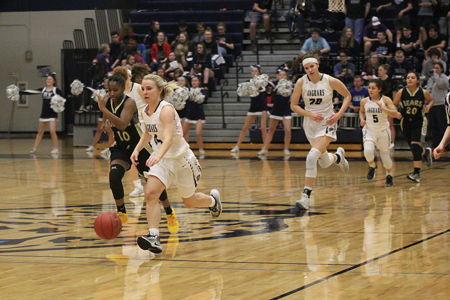 After+stealing+the+ball%2C+senior+Adde+Hinkle+charges+down+the+court.