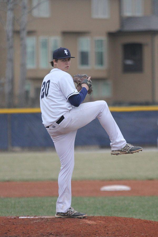 Looking towards home plate, junior Nolan Sprague prepares to throw a pitch.