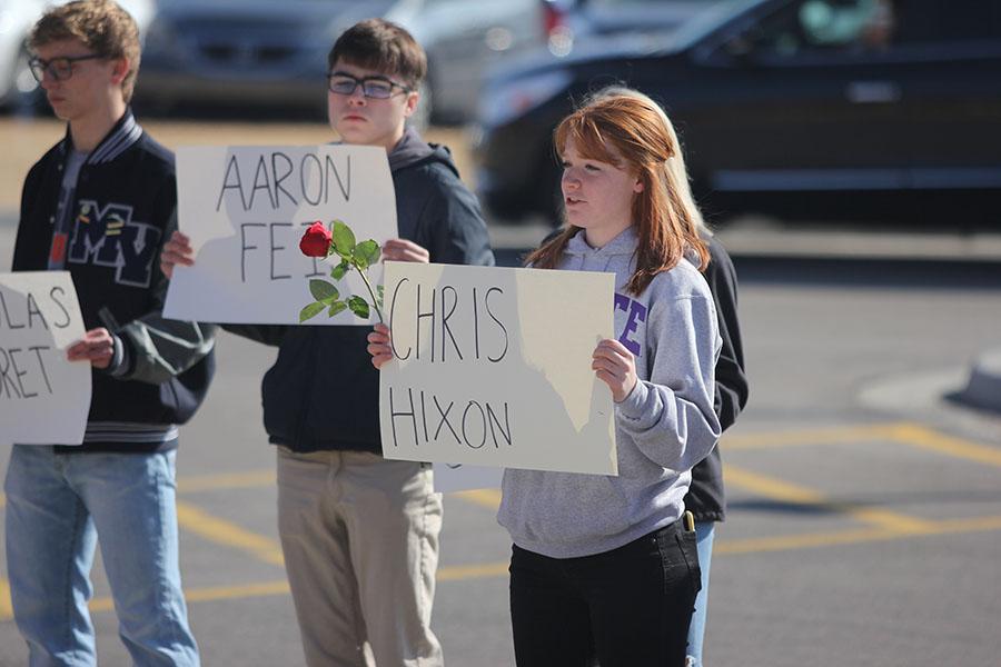 Talking+about+Parkland+victim+Chris+Hixon%2C+junior+Josie+Carey+holds+a+sign.
