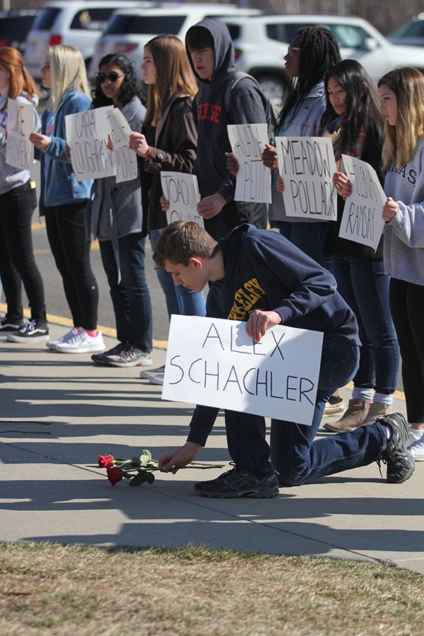 Honoring+Parkland+victim+Alex+Schachler%2C+freshman+Ben+Wieland+lays+a+rose+in+his+name.
