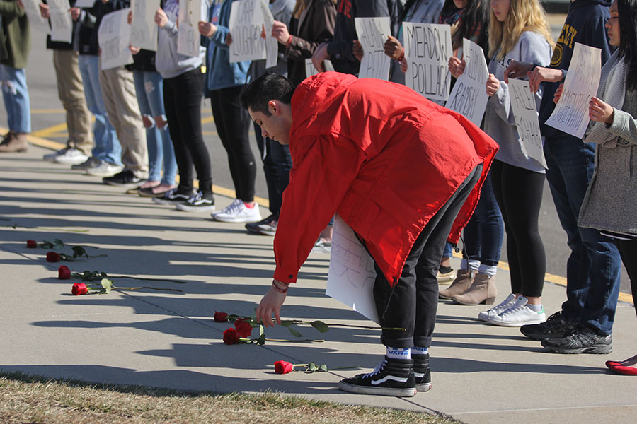 As+he+lays+down+the+last+rose%2C+junior+Dominic+Martinez+honors+the+17th+victim+of+the+Parkland+shooting.