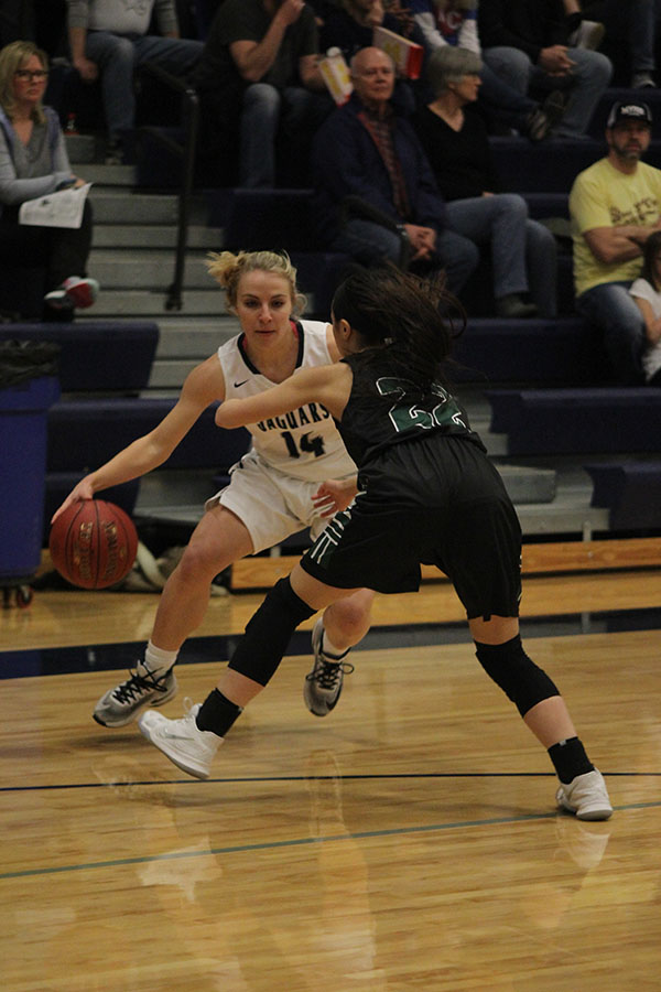 In+a+wide+stance+senior+Adde+Hinkle+attempts+to+move+past+her+opponent.+