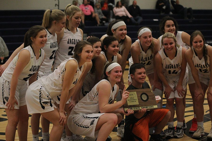 After winning the sub-state championship, the team poses for a photo with junior Matt Santaularia on Saturday, March 3. The girls team won against BVSouthwest 43-24.