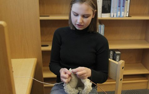 In the library before school on Monday, Feb. 26, senior Marissa Olin knits part of a sweater.
