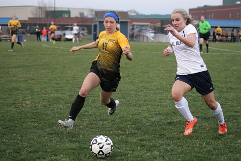 During the first half, senior Adde Hinkle runs by a defender to get the ball on Thursday, April 5.