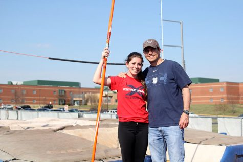 Pole vaulting serves as bonding activity between junior Abby Phillips and new coach Todd Phillips