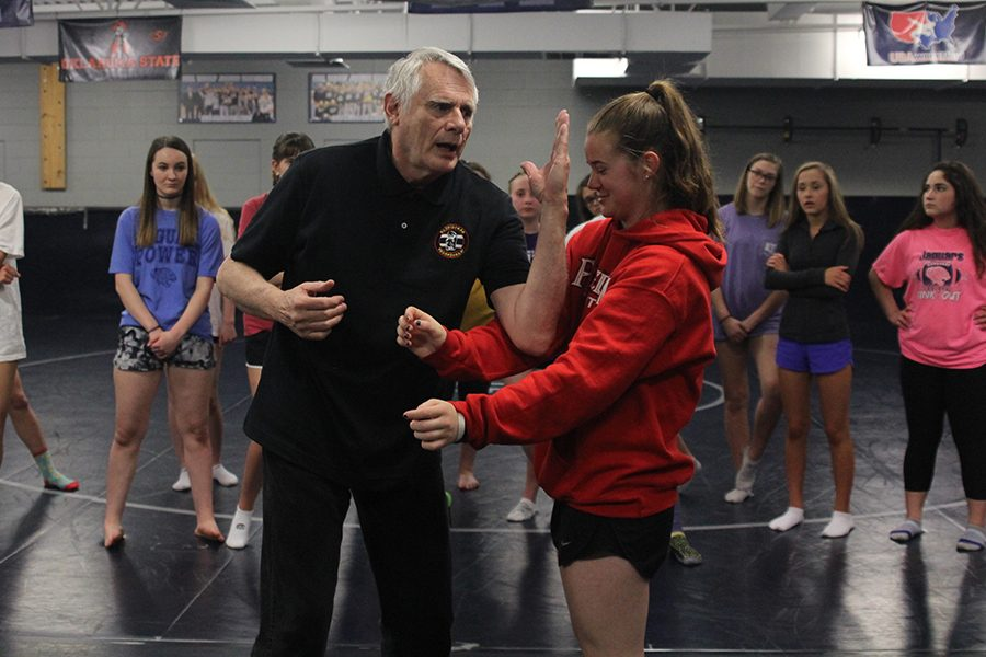 On+Friday%2C+April+13%2C+self-defense+instructor+Steven+Kinser+uses+freshman+Belle+Bonn+to+demonstrate+a+move+in+front+of+silver+four%27s+girls+PE+class.++