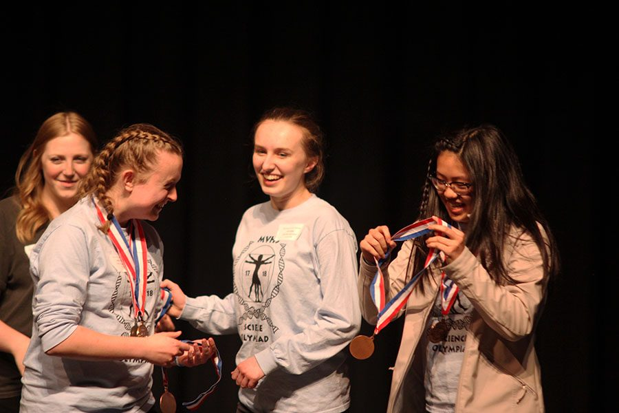 As they are recognized for third place in Experimental Design, freshman Hannah Chern and juniors Sydney Clarkin and Liz Fraka receive medals.