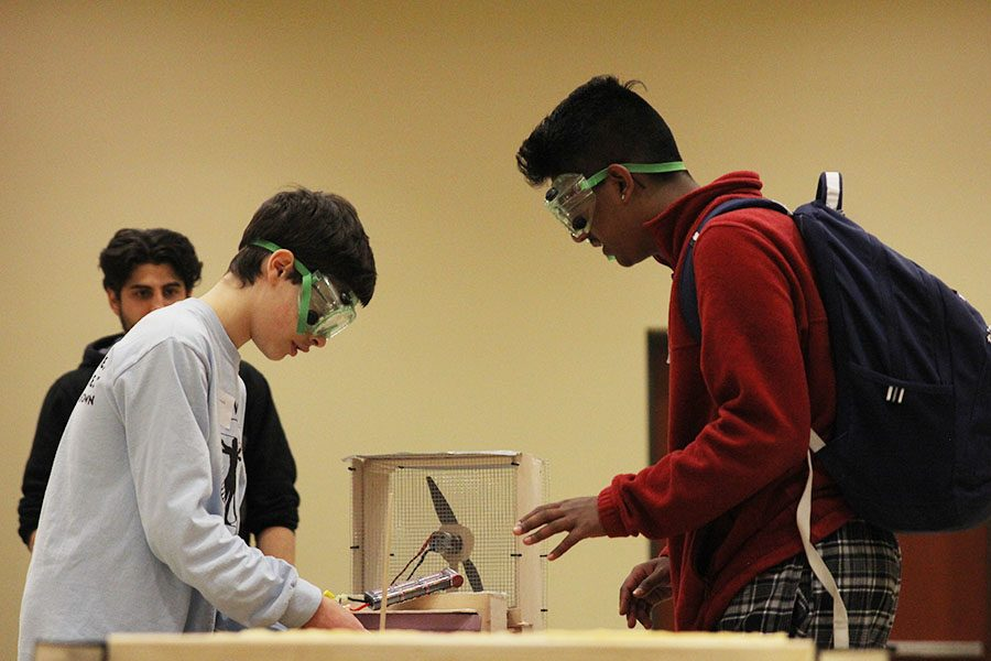 After the completion of the first hovercraft test trial, freshman Alex Whipple moves the battery to alter its path.