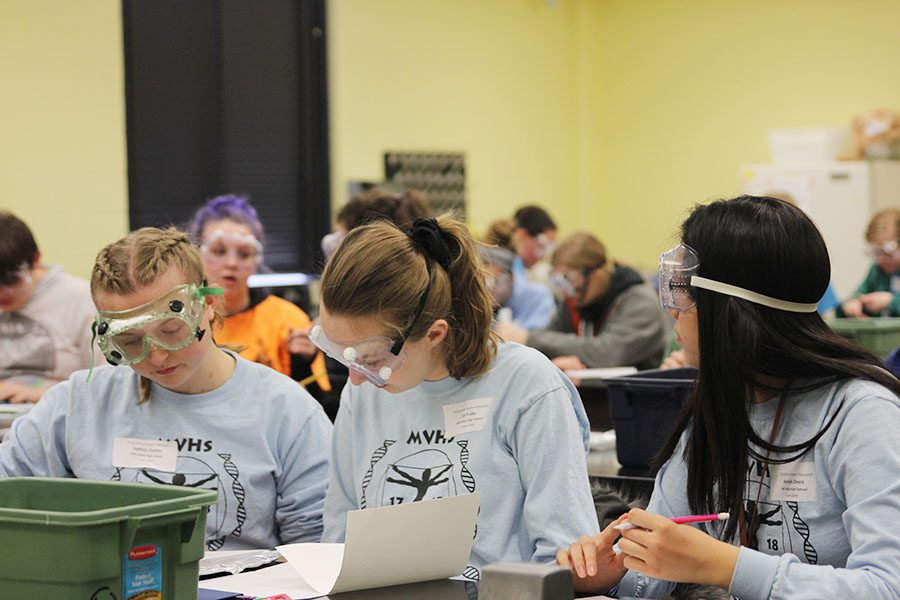 In their final event, juniors Sydney Clarkin and Liz Fraka, and freshman Hannah Chern collaborate on Experimental Design. The group placed third.