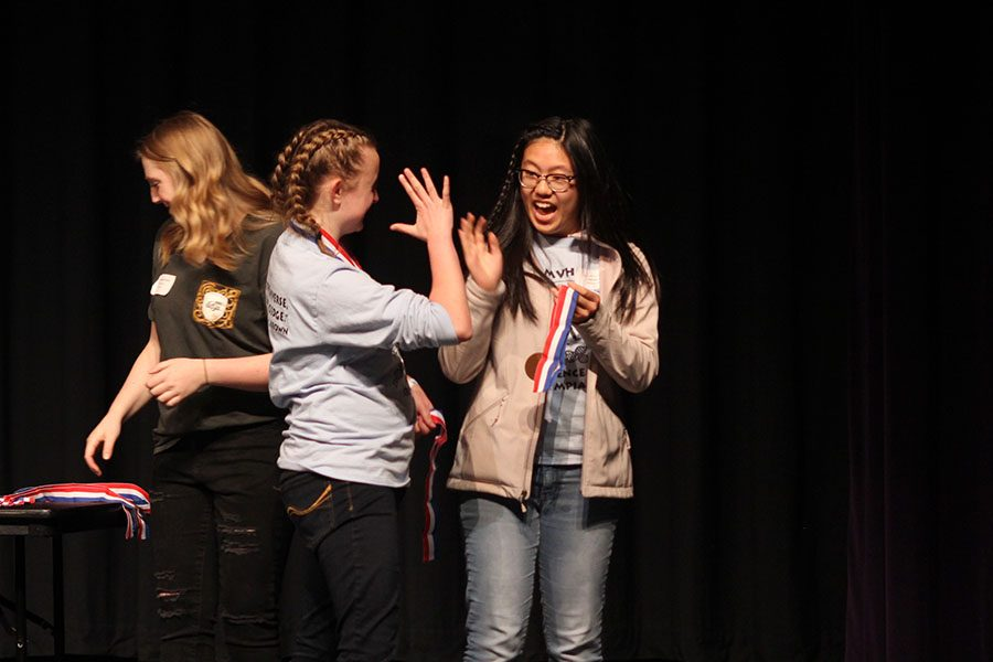 After receiving second place in Anatomy and Physiology, junior Sydney Clarkin and freshman Hannah Chern share a high five.