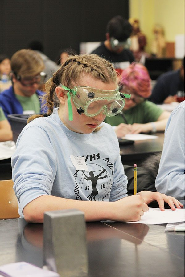 During the Experimental Design event, junior Sydney Clarkin writes a lab report. Competitors must create an experiment based on the parameters and materials given by judges in the event.