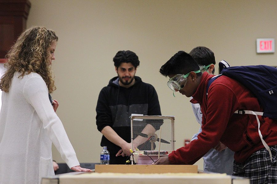 During the first trial of testing, sophomore Srikar Turaga makes an adjustment to the hovercraft.