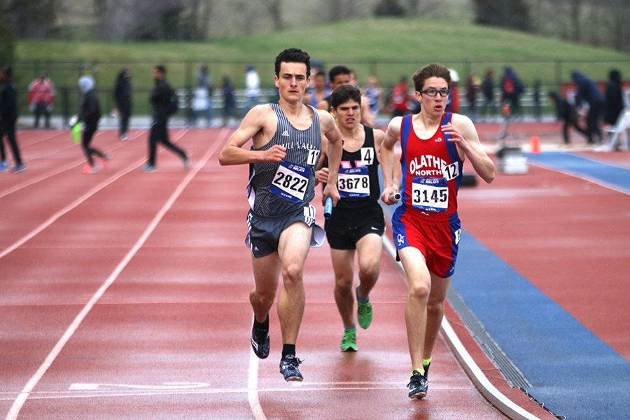In second place, junior Matthew Turner tries to pass an Olathe Northwest runner on Saturday, April 21.