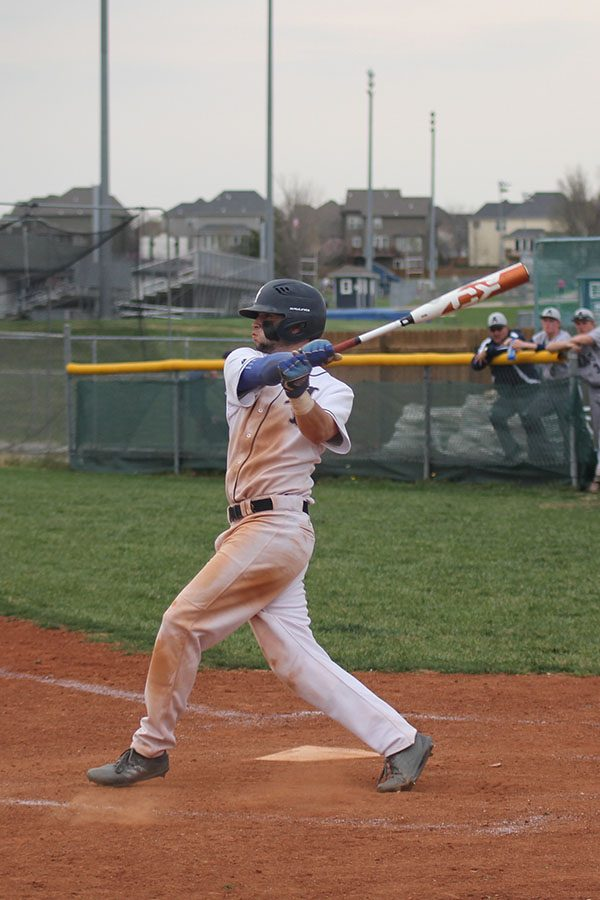 As the ball comes towards him, junior Quinton Hall swings for a hit on Tuesday, April 24.