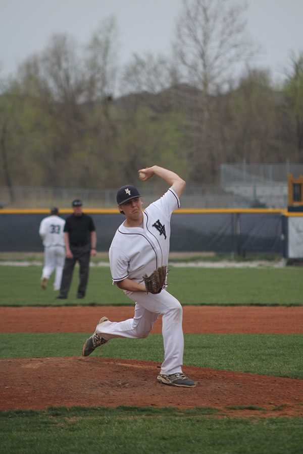 Stepping off the pitcher's mound, junior Nolan Sprague attempts to strike out a hitter from STA.