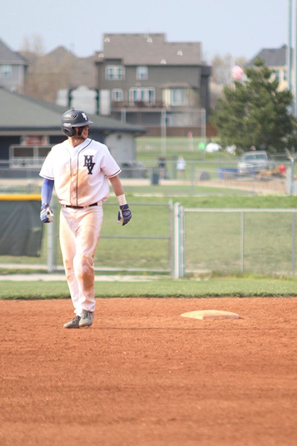 Assessing the positions of the opposing team, junior Quinton Hall attempts to steal third base.