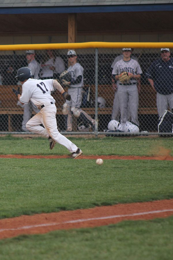 After bunting the ball, senior Will Morris races to first base.