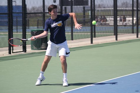 During the EKL tennis tournament on Saturday, April 28, sophomore Joey Gillette passes the ball to his opponent.
