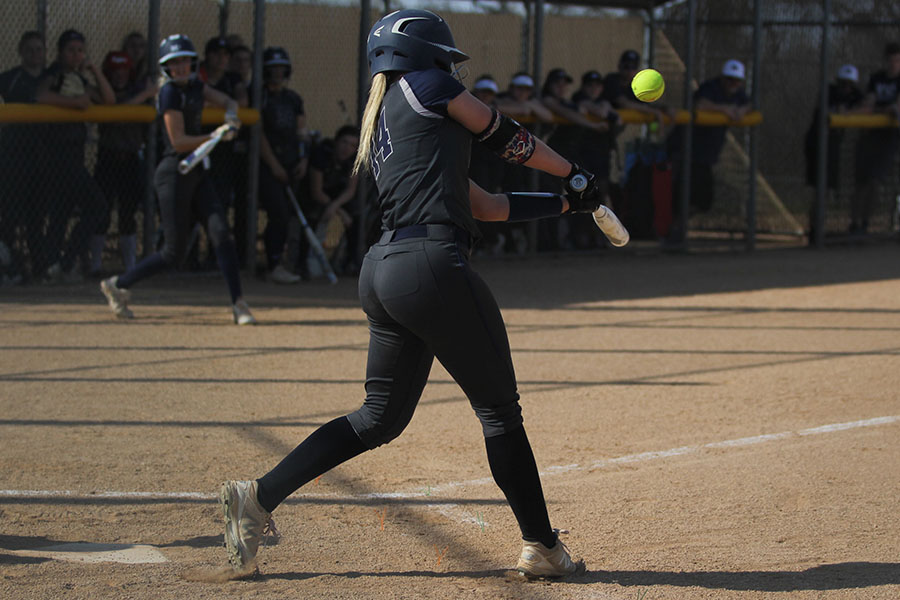 While+watching+the+pitch+come+in%2C+freshman+Ava+Bredwell+hits+the+ball.