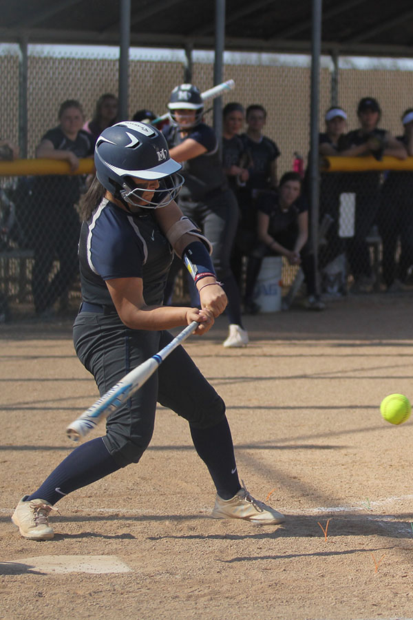 As+the+pitch+comes+in%2C+sophomore+Jessica+Garcia+hits+the+ball.
