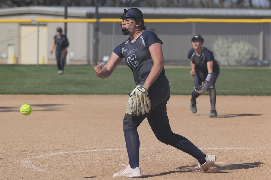 As+she+releases+the+ball+from+her+hand%2C+sophomore+Lauren+Florez+pitches+the+ball.