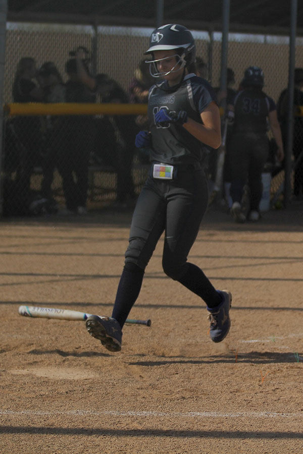 After+a+hit+from+her+teammate%2C+junior+Payton+Totzke+runs+home.