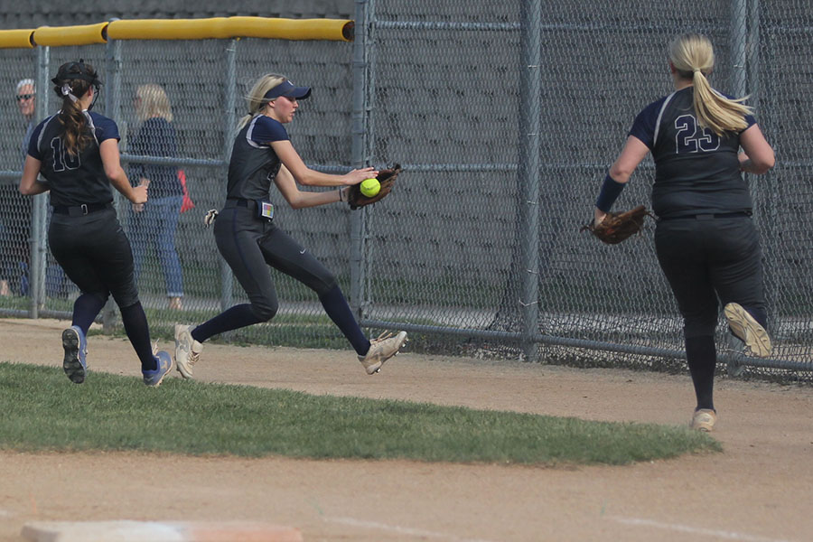After+a+foul+ball%2C+senior+Lilly+Blecha+runs+to+catch+the+ball.