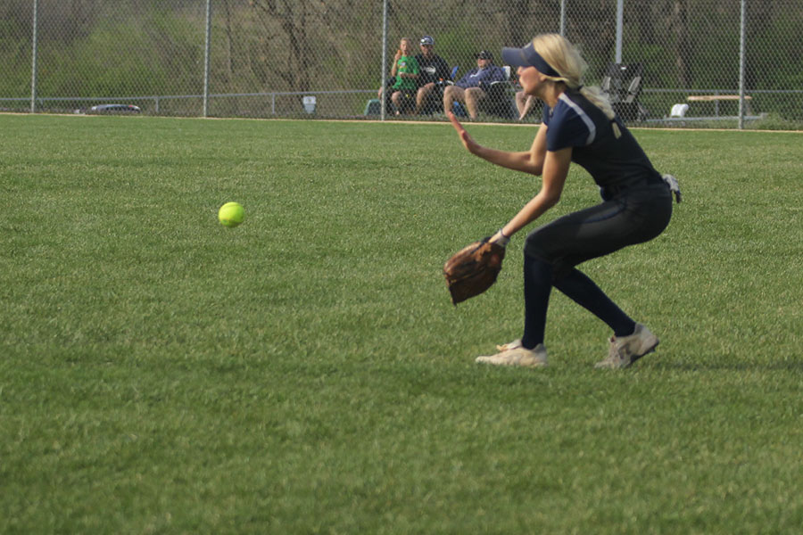 While+standing+in+the+outfield%2C+senior+Lilly+Blecha+catches+the+ball.