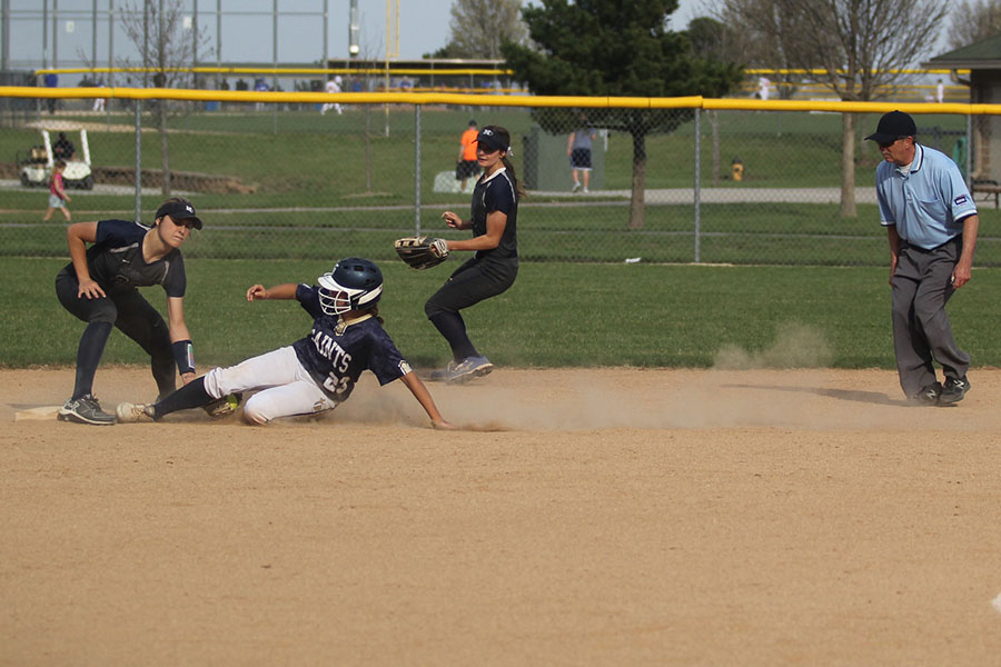 As+her+opponent+slides+in%2C+freshman+Ava+Bredwell+tags+her+out.