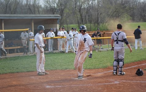 After an error was made by Aquinas, junior Quinton Hall celebrates his run on Tuesday, April 24. The team defeated Aquinas 7-3.