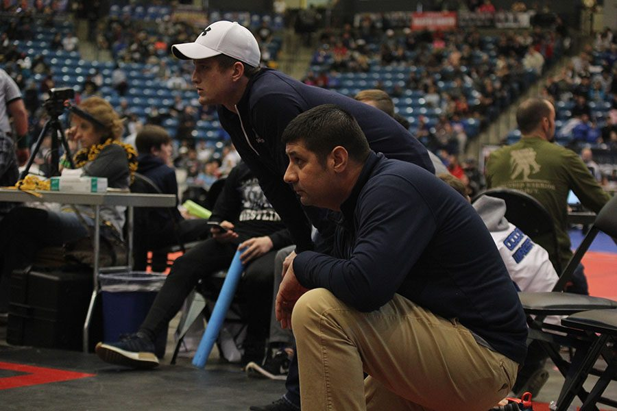 During+the+5A+state+wrestling+tournament+on+Saturday%2C+Feb+24%2C+head+coach+Travis+Keal+watches+a+match.